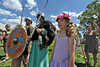 Walt Hester | Trail Gazette<br /> Rebekah Kellums, 7, of Johnstown smiles for a picture with Vikings John Shoults and Emma Veile at the Midsummer Scandinavian Festival on Saturday. The Vikings demonstrated village life and, of course, combat of the famous Scandinavian warriors.