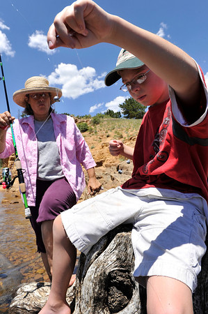 Walt Hester | Trail Gazette<br /> Coleman Conley, 10, of Louisville, Colo., untangles his line at Mary's Lake with the help of his grandmother, Wendy Haeger of Grand Junction. The water is cold, but much warmer than that of the local rivers.
