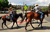 Walt Hester | Trail Gazette<br /> From left, Aliya Carter, 16, Rachel Casey and Sarah Willett of Elkhorn Stables meander through town on Wednesday. The trio were promoting the stables.