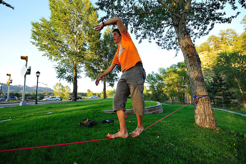 Walt Hester   Trail Gazette<br /> Roy Quanstron of Camp Timberline walks a slackline along the River Walk on Friday evening. The practice requires a great deal of balance, but also developes balance, which has benefits in many other sports and activities.