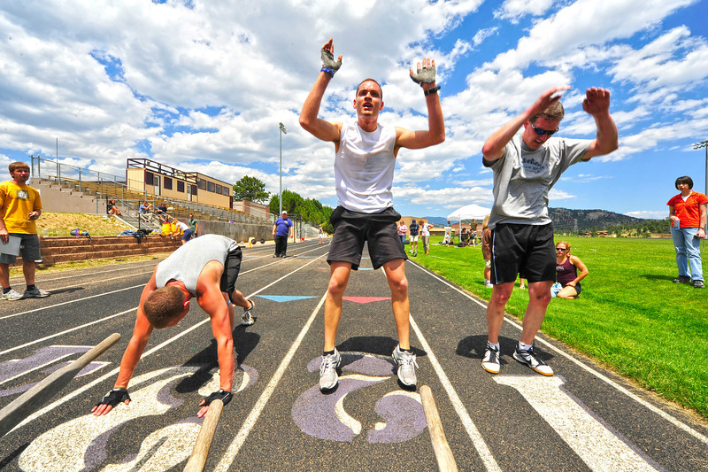 "Walt Hester | Trail Gazette<br /> ""G"" Garcia, center, fights for third place among the Division 1 men in the last workout on Saturday. Garcia has practiced CrossFit for about seven months."