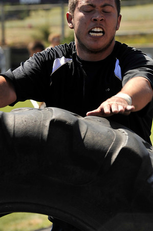 Walt Hester | Trail Gazette<br /> An Eagle Rock student flips a heavy tracktor tire during the games. Several Eagle Rock students and instructors showed up to compete.