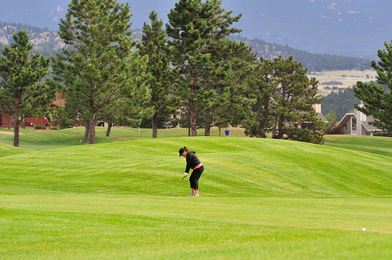 Walt Hester | Trail Gazette<br /> A golfer prepares to drive to the green o the third fairway on the Estes Park Public 18-Hole course on Tuesday. To ensure a dry game, getting to the course earlier woul be better.