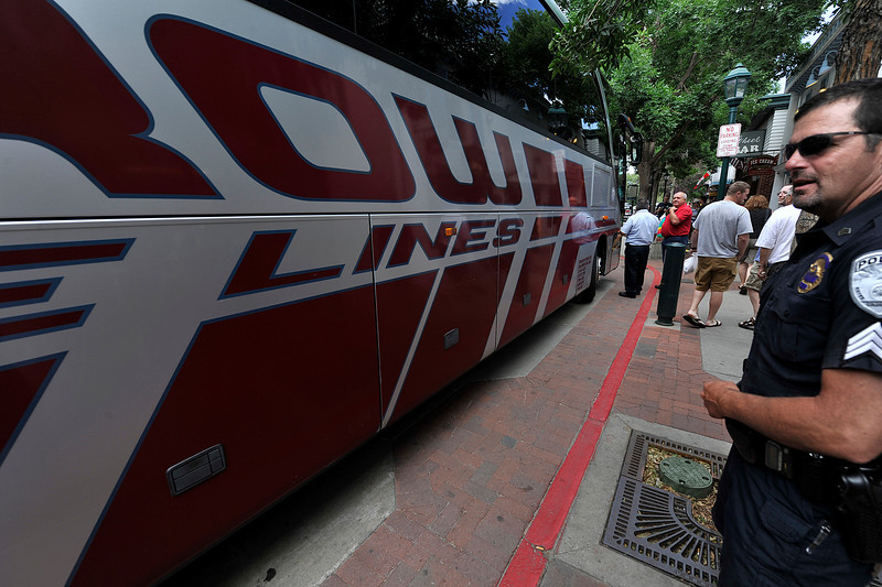 Walt Hester | Trail Gazette<br /> A bus driver boardes his bus on Elkhorn Avenue moments before Estes Park Police planned to tow it. The bus was parked in a well-marked no-parking zone on Elkhorn Avenue.