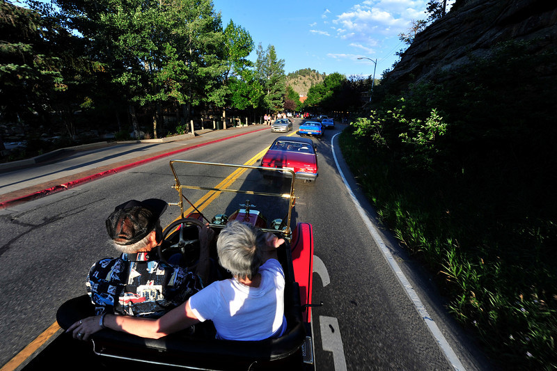 Walt Hester | Trail Gazette<br /> A line o classic cars snake down Elkhorn Avenue on Friday evening. The Estes Park Car Club will host one more Cruz-In on the last Friday of August.