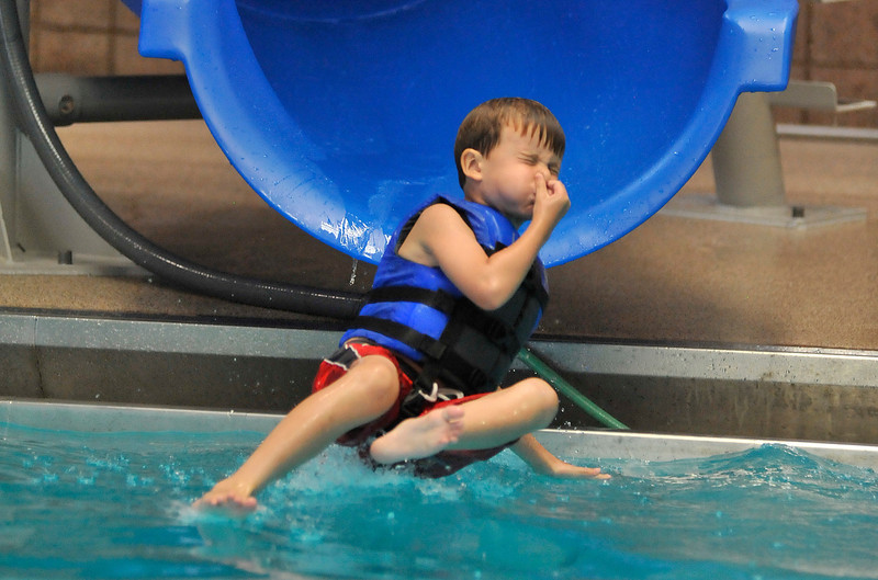 Walt Hester | Trail Gazette<br /> John Burns, 5, of Alba, NM, splashes down off of the new slide at the Estes Park Aquatic Center on Saturday. The slide was installed last week.