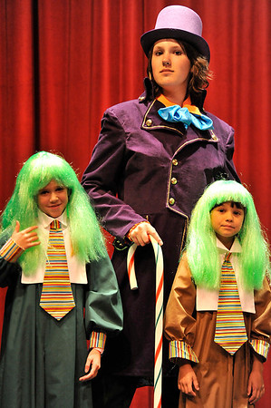 "Walt Hester | Trail Gazette<br /> Willy Wonka and two Oompa Loompas await rehursal at the Estes Park High School auditorium on Thursday. The Fine Arts Guild of the Rockies Youth Theater Group will perform Willy Wonka Jr., a ""kid friendly"" adaptation of the Roald Dahl classic this weekend at the high school auditorium."