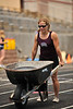 Walt Hester | Trail Gazette<br /> Cathy Lewis, one of the lightest athletes in Saturday's Estes Park CrossFit Games, pushes a wheelbarrow loaded with nearly her own weight. Lewis won the Division 1 Women's competition.