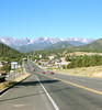 Bright blue skies outline the peaks of the Continental Divide to the west of Estes Park.
