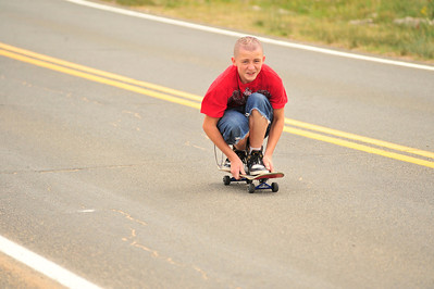 Walt Hester | Trail Gazette A young skater glides down Community Drive toward the Estes Valley Skate Park on Friday.