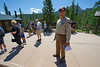 Walt Hester | Trail Gazette<br /> Park volunteer Bob Loeffelman smiles as he helps visitors at the Glacier Gorge Trailhead on Tuesday. The national park reports visits have increased as the summer has continued.