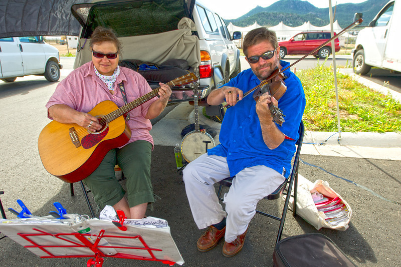 Walt Hester | Trail Gazette<br /> Patti and Bill Cummings, collectively known as Traditional Blend, play for visitors to the Estes Valley Farmers' Market. Music as well as produce, baked goods and crafts welcome those who visit the market on Thursday mornings.