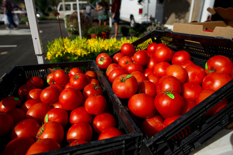 Walt Hester | Trail Gazette<br /> Bright, ripe tomatoes shine at the Estes Valley Farmers' Market. The market, open every Thursday at the Stanley Fairgrounds, will have lots of fresh produce through September.