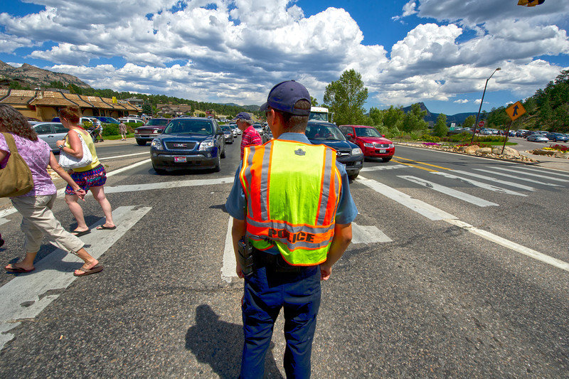 Walt Hester | Trail Gazette<br /> Weekend motor and foot traffic overwhelm the traffic lights in downtown Estes Park on Saturday. Traffic was backed up from the Elkhorn-Moraine avenues intersection all the way out to Lower Stanley Village and the Visitor Center.