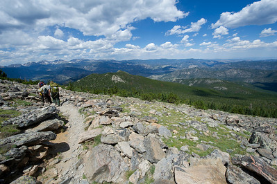 Walt Hester | Trail Gazette The Estes Valley vista spreads out for hikers on the northern slope of Twin Sisters. Along with the peaks of the Divide and Longs Peak, the Twin Sisters are among the most recognizable peaks around Estes Park.