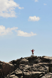 Walt Hester | Trail Gazette A hiker stands against a clear sky atop Twin Sisters on Monday. The weekend should, again, be clear and warm in the Estes Park area.