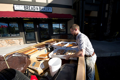 Walt Hester | Trail Gazette Christopher Reppert loads up for tasty deliveries on Friday. Many of Estes Park's small business owners are up with the sun and at there work seven days a week.