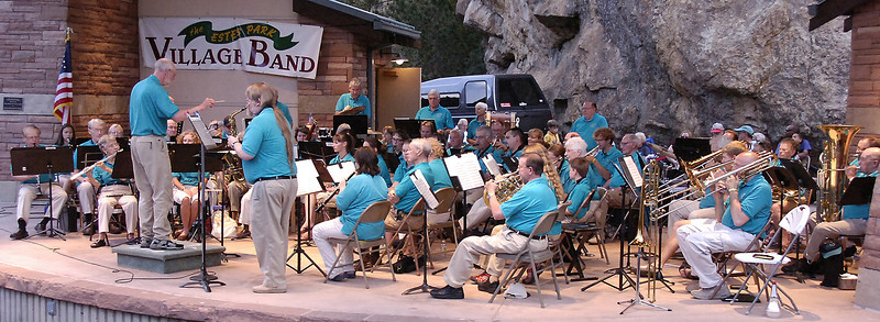 The Estes Park Village Band on stage in Performance Park. The band is made up of local musicians.