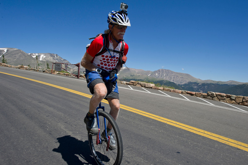Walt Hester | Trail Gazette<br /> Mike Tierney of Aspen descends Trail Ridge Road on a unicycle on Saturday. Tierny has pedaled over all of Colorado's Continental Divide roads in his training to climb Hawaii's Mauna Loa.