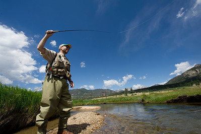 Walt Hester | Trail Gazette Kevin Fricke of Denver casts his line in the Big Thompson River in Moraine Park on Wednesday. While storms threatened early in the day, sunshine prevailed.