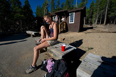 Walt Hester | Trail Gazette Sarah Almond of Estes Park prepares for a hike at the Longs Peak Trailhead on Saturday. The trailhead is extremely popular in August, with cars parking on the road up to a mile away.