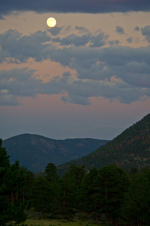 Walt Hester | Trail Gazette<br /> The full moon hangs over Estes Park on Saturday. While beautiful in itself, the bright moon obscured the Perseids Meteor Shower over the weekend.
