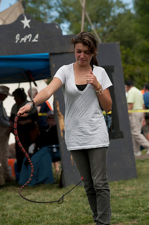 Walt Hester | Trail Gazette<br /> Esabella Perugini, 13,of Broomfield attempts to crack a whip on Saturday. Children and families were the focus in the Heritage Festival.