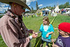 "Walt Hester | Trail Gazette<br /> Bruce ""Ranger Red"" Schnelle of Highlands Ranch hands out keepsakes during the Heritage Festival. Schnelle was part of an old West shooting demonstration."