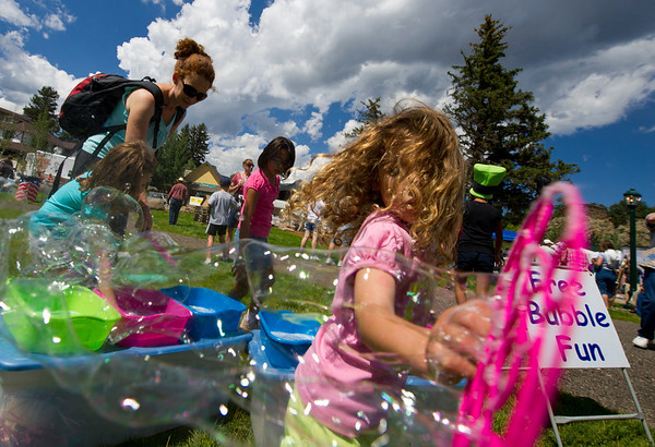 Walt Hester | Trail Gazette<br /> Bubbles and curls and sunshine filled the park on Saturday. Children had many opportunities to play and learn with a petting zoo, cabin building and bubble station.