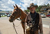"Walt Hester | Trail Gazette<br /> Terry ""Doc"" Humphrey of Glacier Creek Stables and his horse, Cheyenne, visit the Heritage Festival on Saturday. Doc fit right in with his cowboy garb."