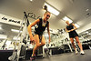 Walt Hester | Trail Gazette<br /> Kate Hewson and Ellie Ciezczak add weight to their swim starts in the high school's weight room on Tuesday. Many sports are finding new and specific ways to add weights to their training.