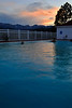 Walt Hester | Trail Gazette<br /> Wednesday's sunset paints the sky and the surface of the pool at the Stanley Hotel on Wednesday. Warm temperatures have persisted late enough to invite swimmers out after sunset.