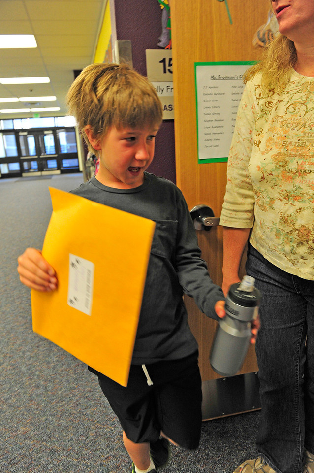 Walt Hester   Trail Gazette<br /> Logan Goodemote has his waterbottle and school folder as he heads into his first day of fourth grade on Monday. Park R-3 Schools started classes for the 2011-12 school year this week.