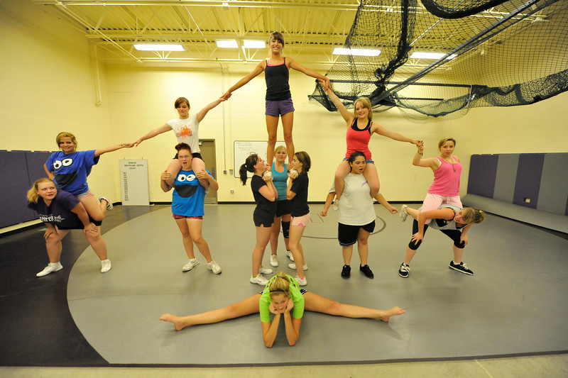 Walt Hester | Trail Gazette<br /> The Estes Park High School cheer squad practice a sort of pyramid in the wrestling room on Tuesday. The cheerleaders perform throughout the fall and winter at athletic events for the school.