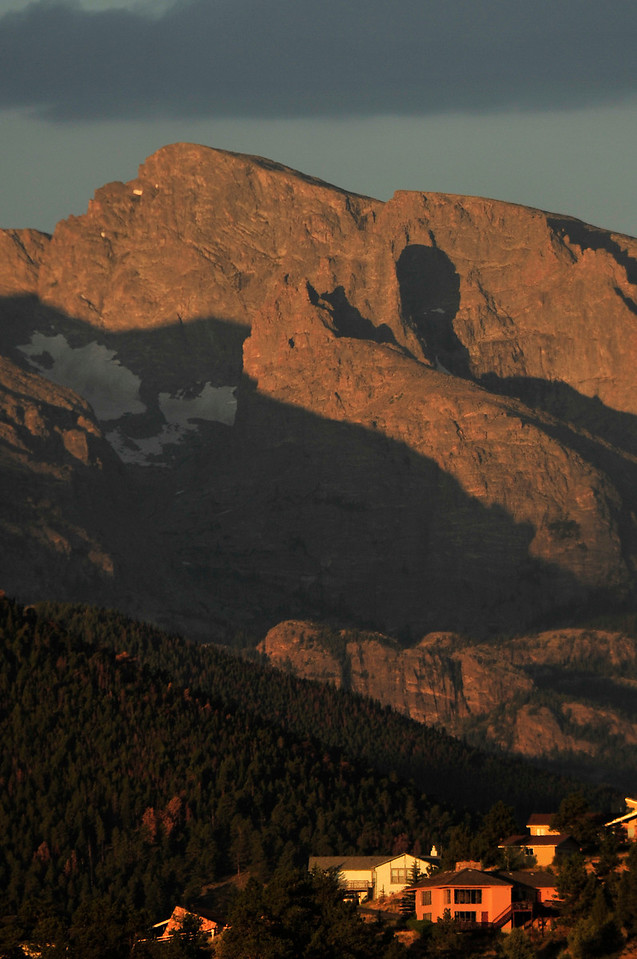 Walt Hester | Trail Gazette<br /> Autumnal shadows wrap the craggy slopes of Rocky Mountain National Park as sunrise lights the high peaks and homes down in Estes Park. Cooler weather is expected for the Estes Park area for the Labor Day Weekend.