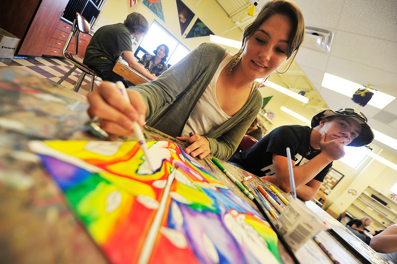 Walt Hester | Trail Gazette<br /> Kristina Bryson, 17, works on a colorful watercolor painting in an afternoon art class at Estes Park High School on Monday. Projects have already begun in this second week of classes for Park R3 schools.