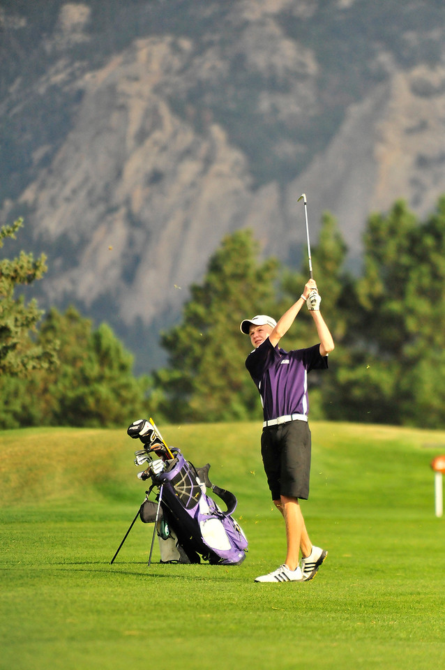 Walt Hester   Trail Gazette<br /> Bobcats' sophomore golfer Dylan Jirsa drives during Thursday's Estes Park Invitational Tournament. Jirsa has turned into a leader in the young squad, helping the 'Cats prepare for the regional golf tournament in Greeley later this month.