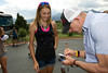 Walt Hester | Trail Gazette<br /> Laurel Rathbun of Monument gets an autograph from US cycling legend-turned-TV personality, Bob Roll, on Monday. Roll rode for the seminary 7-Eleven cycling team from the '80s, while Rathbun is, herself, a competitive cyclist, having ridden the Aspen Cross race in Estes Park last fall.