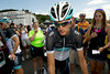Walt Hester | Trail Gazette<br /> Two-time Tour de France runner-up Andy Schleck weaves his way through the gathered throng outside the Leopard-Trek team bus on Monday. Fans are able to walk up and touch their heros in cycling, even just minutes before they perform.