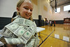 Walt Hester | Trail Gazette<br /> Annalice Basch, 10, is swaddled in dollar bills during the ABC fundraiser assembly on Wednesday. The fundraiser will help fund field trips and technology perchases at the elementary school.