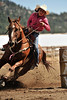 Walt Hester | Trail Gazette<br /> Young racer Dolly Iodosio steers her horse, Short Shot around the final barrel on Sunday. The barrel races encouraged racers of all agaes and abilities to join in.