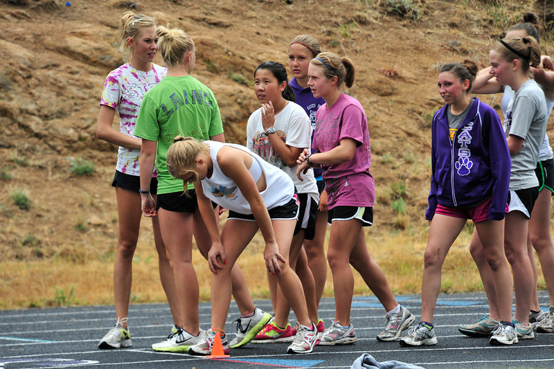 Walt Hester | Trail Gazette<br /> Ladycats line up to run, again, on the track at Estes Park High School on Tuesday. The tem performed short, intense repeats for power.