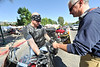 Walt Hester | Trail Gazette<br /> Jon Landkamer takes donations for the Estes Park Volunteer Firefighters' Fill the Boot campaign on Sunday. The annual event raises money for the Muscular Dystrophy Foundation.