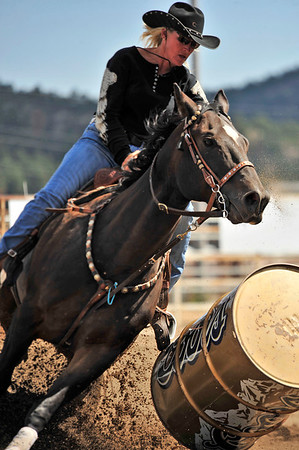 Walt Hester | Trail Gazette<br /> Renee Rownd cuts the turn a bit too close as she bumps the barrel during her Sunday run. Riders are penalized for knocking down barrels during the races.