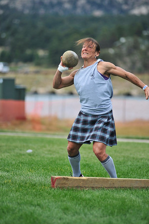 Walt Hester | Trail Gazette<br /> Mary Beth Litsheim of Grand Junction throws a stone during the Highland Games events on Sunday. Litsheim, a 50-year-old mother of four has a maximum squat of 279 and a deadlift of 305.