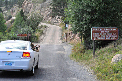 Walt Hester | Trail Gazette National park visitors stop on Monday to phoograph the sign designating the start of the Old Fall River Road. Park officials reported that they plan work on the old road this fall.