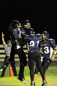 Walt Hester | Trail Gazette Bobcats celebrate Friday night after Frankie KellerTwigg, No. 13, right, threw a short pass to Adam Christianson, left, in the second quarter of the first home game of the season against Lyons. The Bobcats lost the battle of North St. Vrain 50-6.