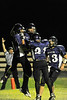 Walt Hester | Trail Gazette<br /> Bobcats celebrate Friday night after Frankie KellerTwigg, No. 13, right, threw a short pass to Adam Christianson, left, in the second quarter of the first home game of the season against Lyons. The Bobcats lost the battle of North St. Vrain 50-6.
