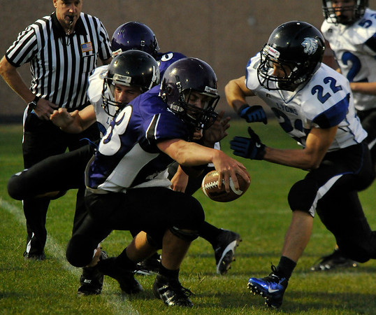 Walt Hester | Trail Gazette<br /> Frankie KellerTwigg reaches for extra yardsagainst the stingy Lyons defense on Friday. KellerTwigg, while a sophomore, has begun to show leadership at quarterback.