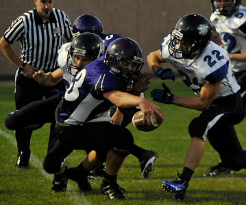 Walt Hester | Trail Gazette Frankie KellerTwigg reaches for extra yardsagainst the stingy Lyons defense on Friday. KellerTwigg, while a sophomore, has begun to show leadership at quarterback.